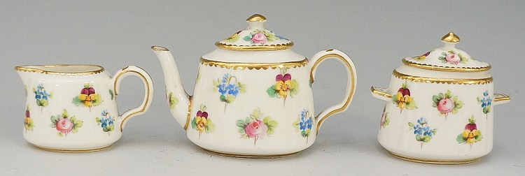 A Minton's miniature three piece porcelain tea service, each piece finely d