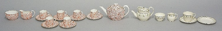 A Spode tea service, transfer printed in iron red with flowerheads and leaf