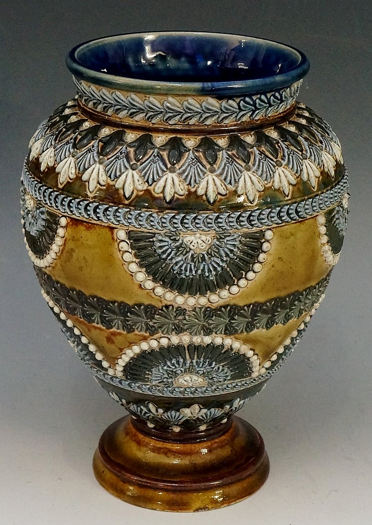 A Royal Doulton pedestal urnular vase, decorated overall with foliate borde