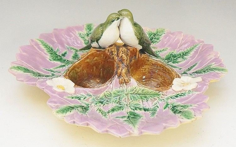 A Victorian Majolica strawberry dish of leafy form, the centre with pair of