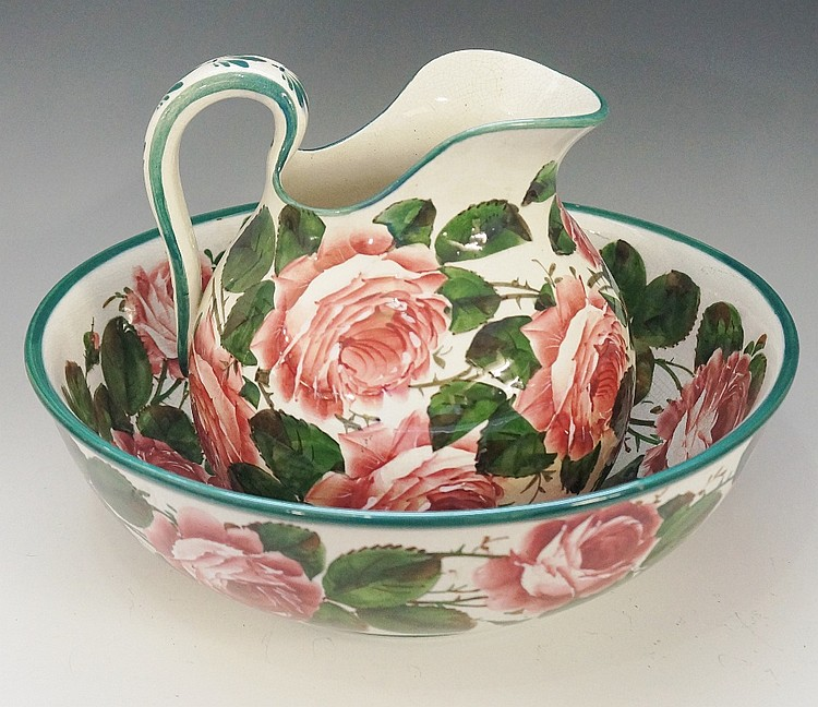Wemyss - a good mouth ewer and circular bowl, decorated overall with rose s