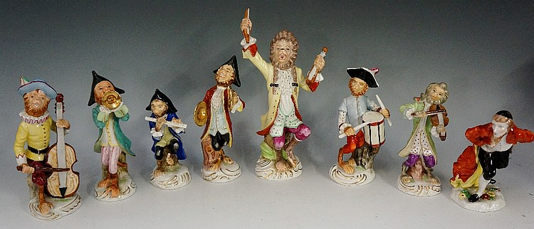 Seven continental porcelain monkey band figures, 22cm high and smaller; a N