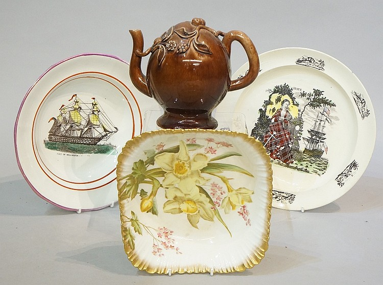 A Brameld treacle glaze Cadogan teapot, relief moulded with flowers, fruit