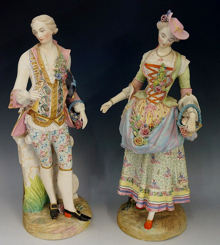 A good pair of continental bisque porcelain figures of a gallant and his co
