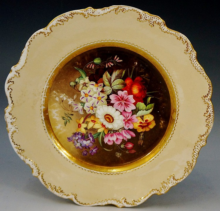 A Coalport shaped circular cabinet plate finely painted to the centre with