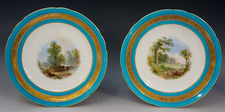 A pair of Minton shaped circular cabinet plates, each painted to the centre