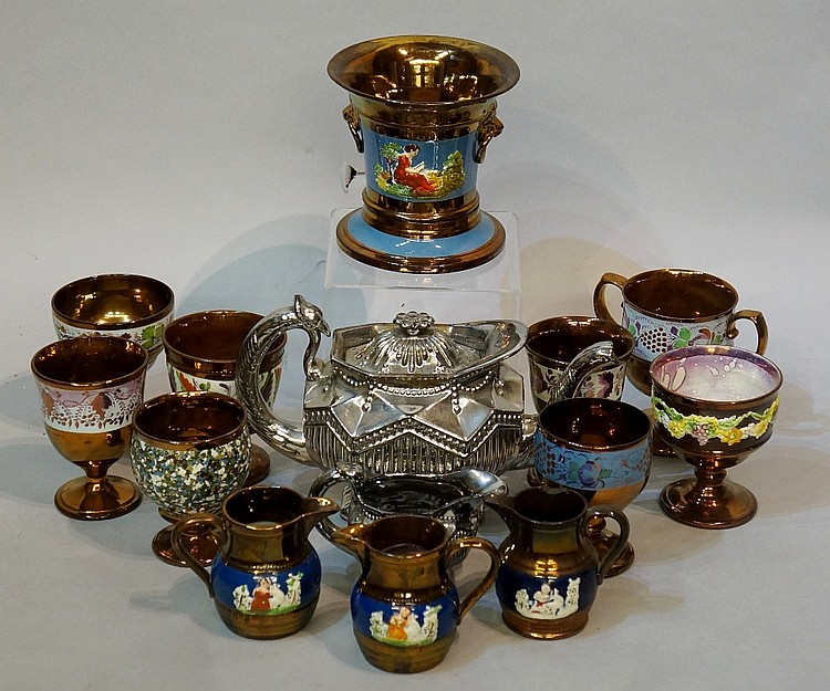 A quantity of copper lustre ware including: cachepot and stand, 14cm high;