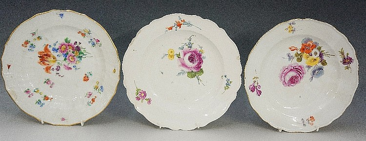 Two Meissen shaped circular plates painted with floral sprays, 23.5cm diame