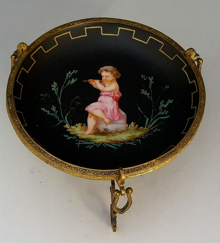 A mid 19th Century continental porcelain circular dish in engraved gilt met