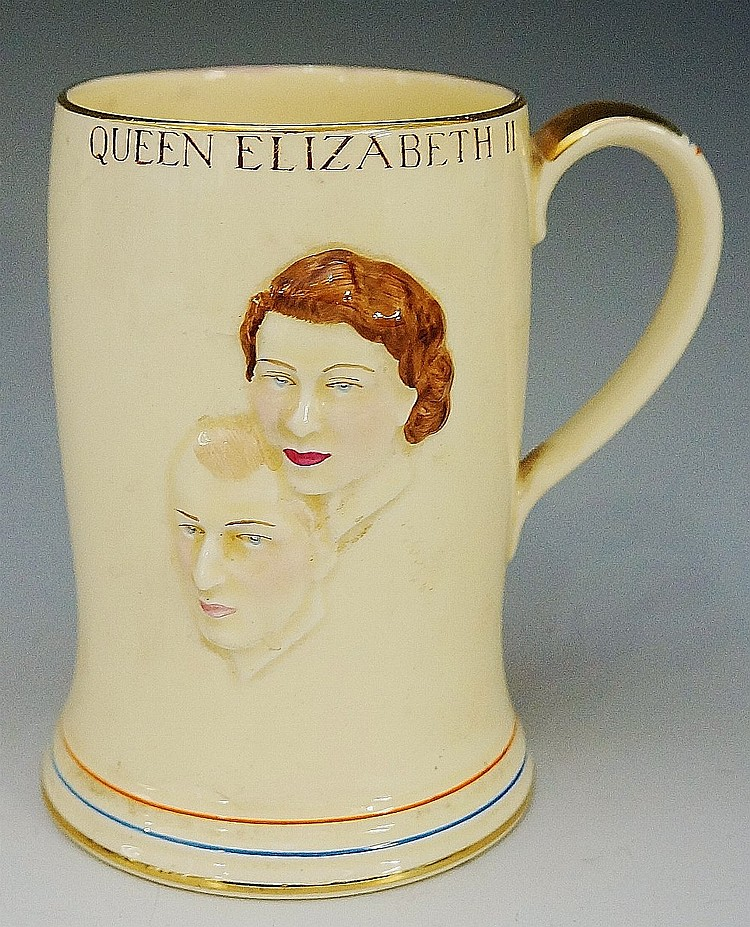 A Crown Devon Fieldings Coronation musical mug, relief moulded with Prince