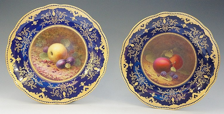 A fine pair of Coalport still life painted shaped circular cabinet plates,