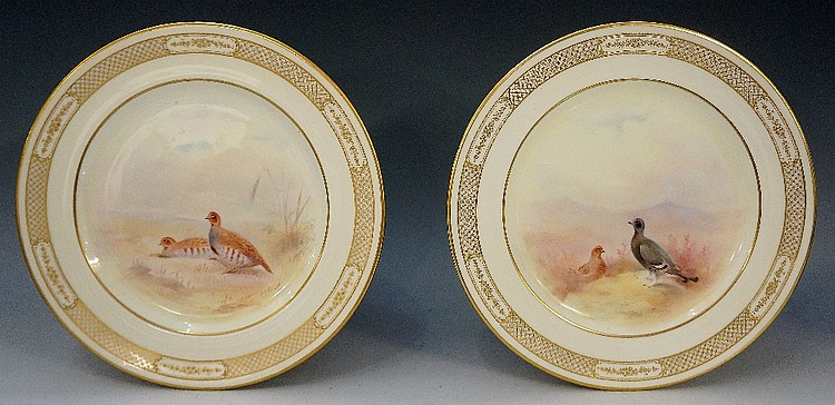 A pair of Royal Doulton cabinet plates painted to the centres with black gr