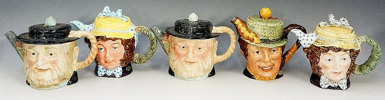 Five Beswick character teapots: Peggitty (2), Dolly Varden (2), and Sam Wel