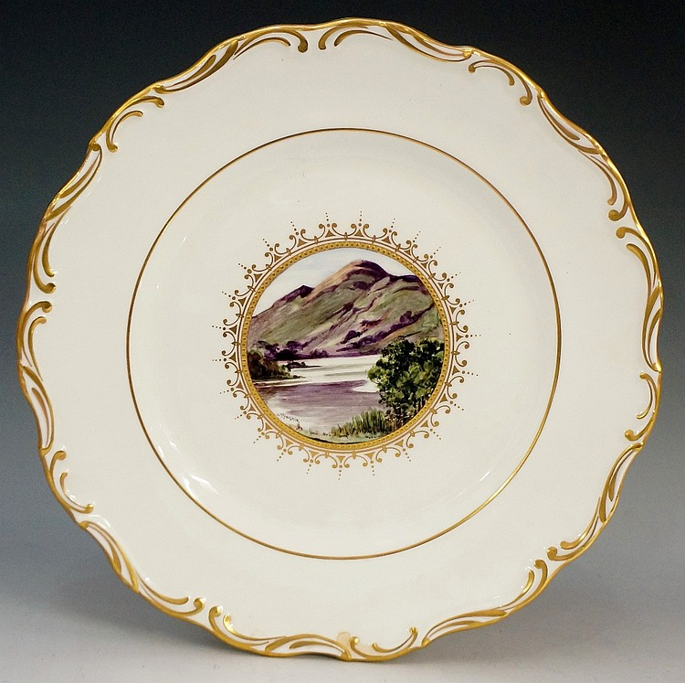 A John McLaughlin shaped circular cabinet plate, painted to the centre with