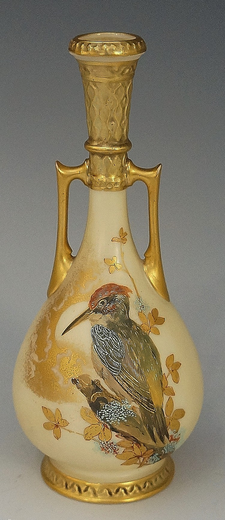 A Worcester two handled bottle shaped vase with moulded gilt neck and handl