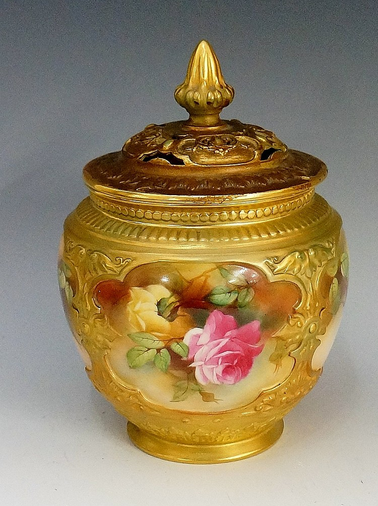 A Worcester porcelain globular vase and cover, the lid with foliate wrapped