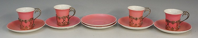 Six Aynsley pink ground saucers together with four matching cups, silver pi