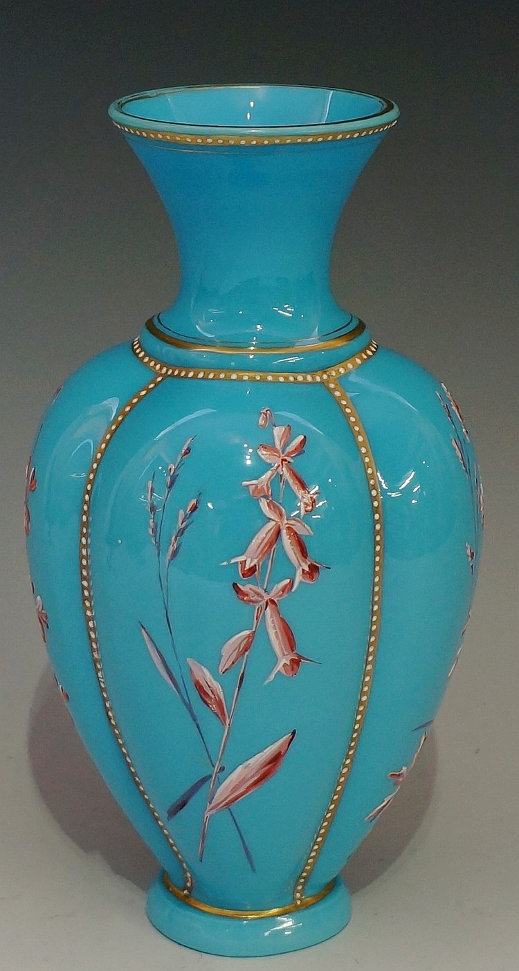 A baluster form glass vase, turquoise ground with differently designed pink