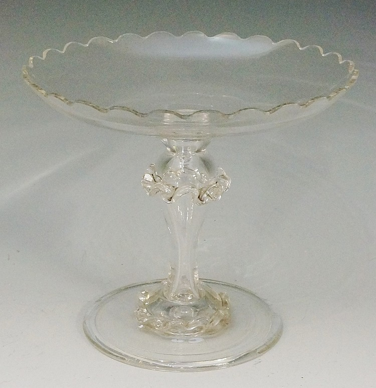A mid Victorian scalloped edged tazza, the hollow stem decorated with appli
