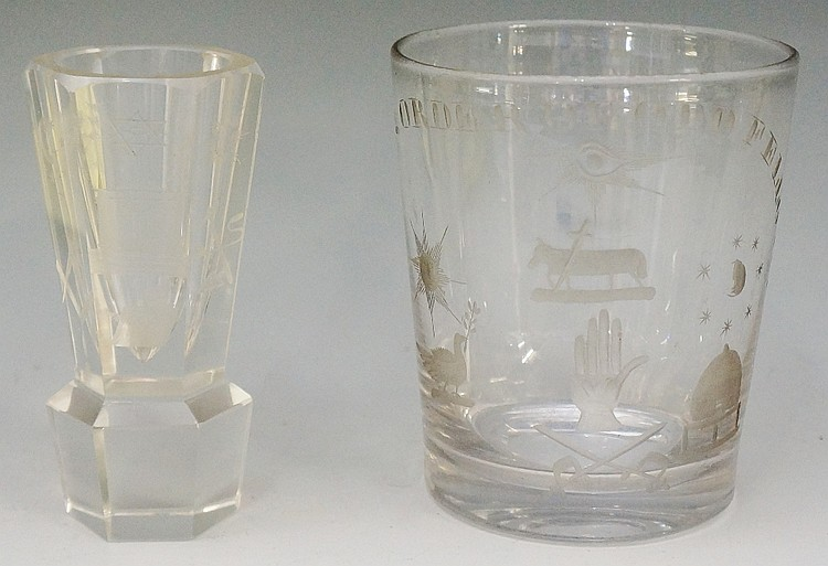A Victorian oversized glass tumbler engraved with various symbols beneath a