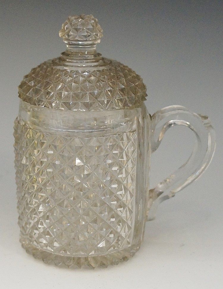 A Victorian diamond cut glass tankard, conforming knopped cover, applied ha