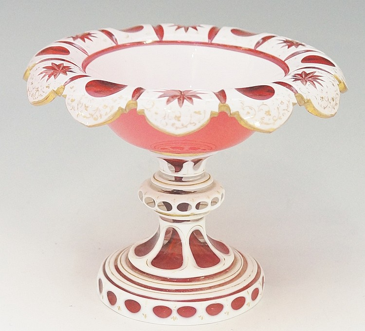 A Victorian white cased cranberry glass tazza, the scalloped rim star and c