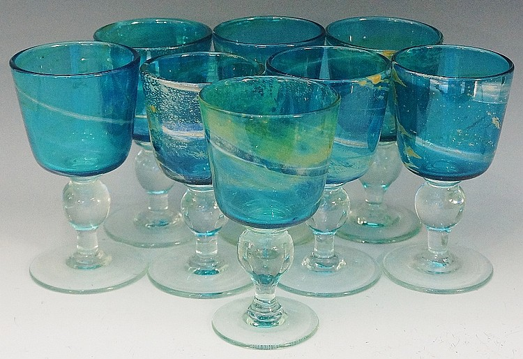 A set of eight Mdina glass goblets, lustred turquoise bowls with irregular