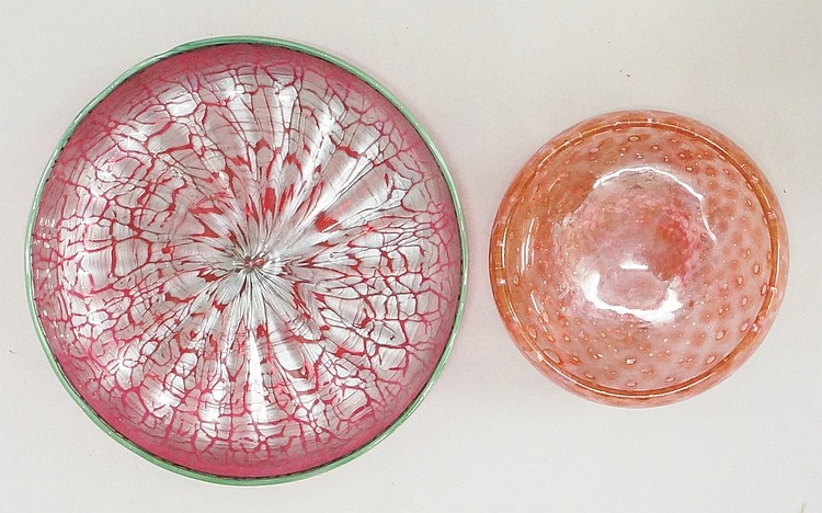 A large art glass dish, fuchsia ground, the interior silver mottled, applie