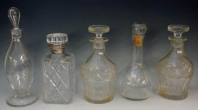 A collection of 19th and 20th Century decanters to include: a near pair of