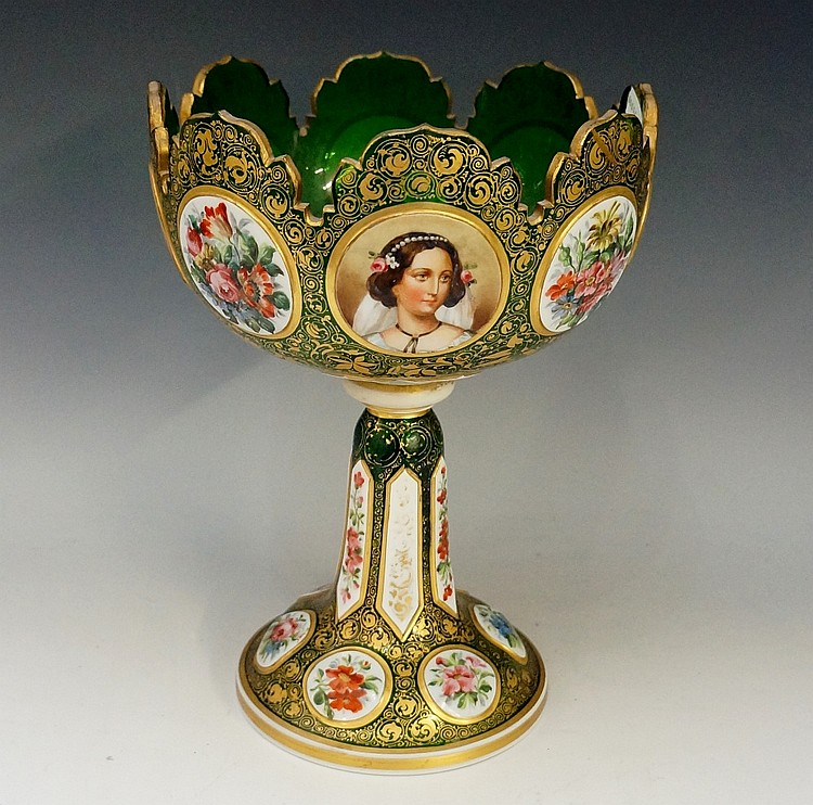 A Victorian overlay green glass pedestal bowl, the bowl with eight painted