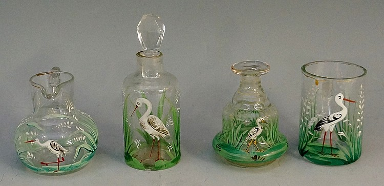 A selection of four pieces of miniature glassware comprising: a jug, a tank