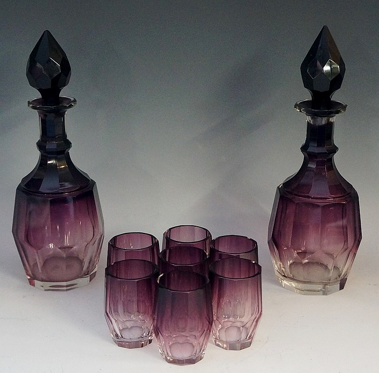 A pair of Art Deco spirit decanters with set of seven matching glasses, all