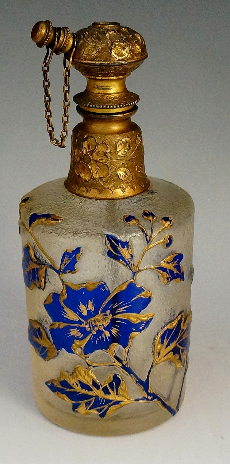A large perfume atomiser, the body cameo cut with blue flowers and foliage