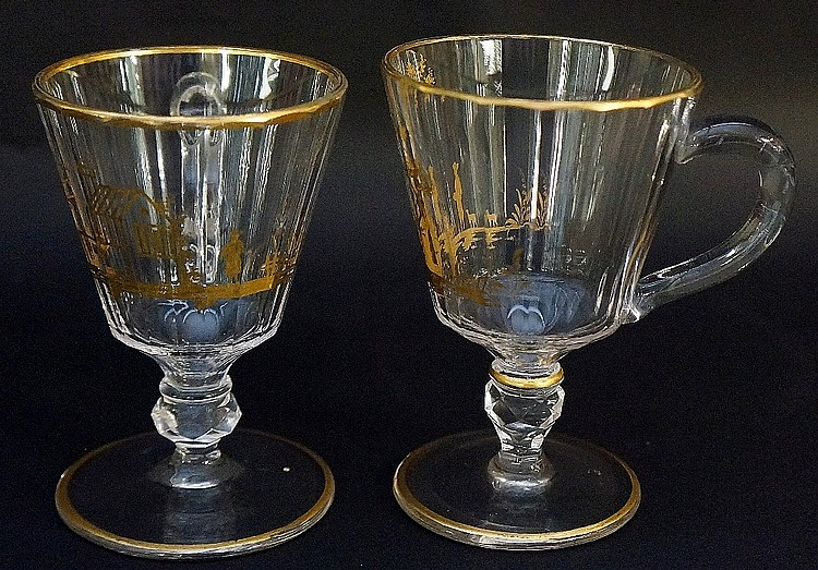 A near pair of punch cups, the slice cut bowls with gilded pastoral scenes,