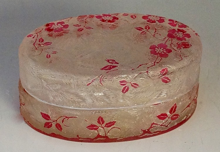 Baccarat - An oval trinket box and cover, cameo cut with pink roses and bri