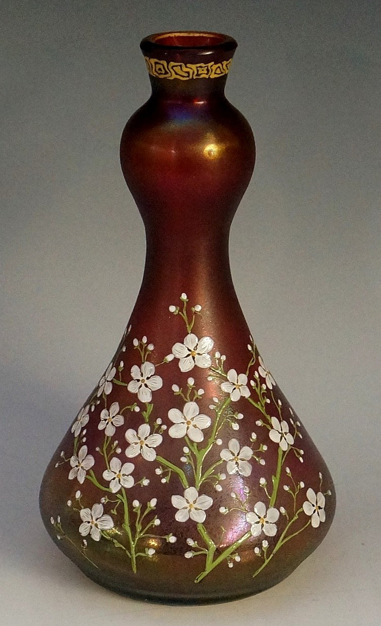 An Austrian Art Nouveau spreading cylindrical iridescent red glass vase, en