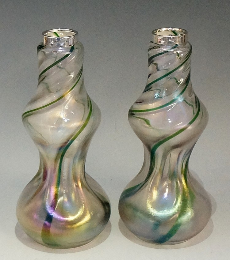 A pair of Art Nouveau Bohemian waisted and dimpled glass vases, decorated i