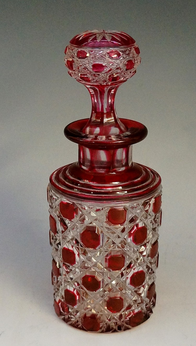 A late 19th / early 20th Century perfume bottle, the cranberry flashed body