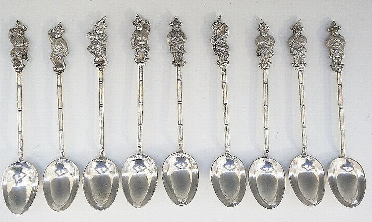 A set of nine Chinese silver teaspoons, the tops cast and engraved as Chine