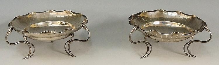 A pair of Chinese silver bonbon dishes, the bodies in the form of flowers w