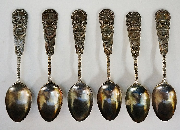 A set of six late 19th Century Chinese silver teaspoons, five of the six wi