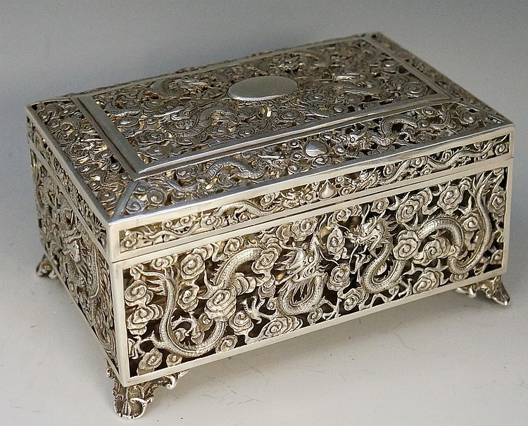 A Chinese silver box, the pierced lid and sides elaborately chased and embo