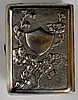 A Chinese silver cigarette case, the body chased and repoussé decorated wit