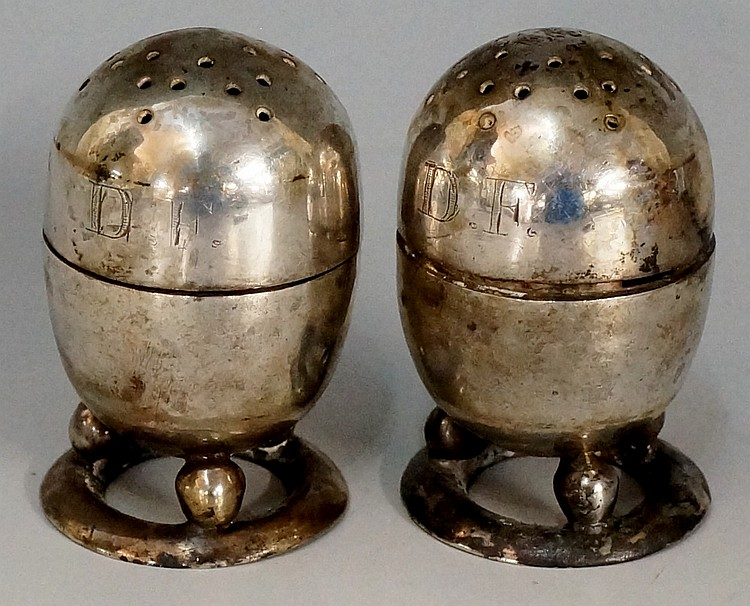 A pair of early 20th Century Chinese silver pepperettes, pellet form bodies