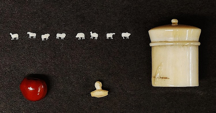 A small cylindrical ivory pot, the slightly domed screw down cover with bal