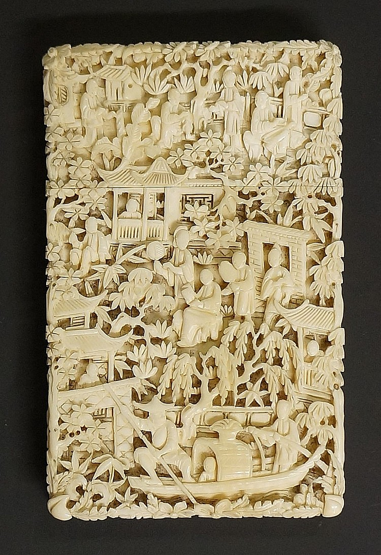 A Cantonese ivory card case finely relief carved with figures in temple gro
