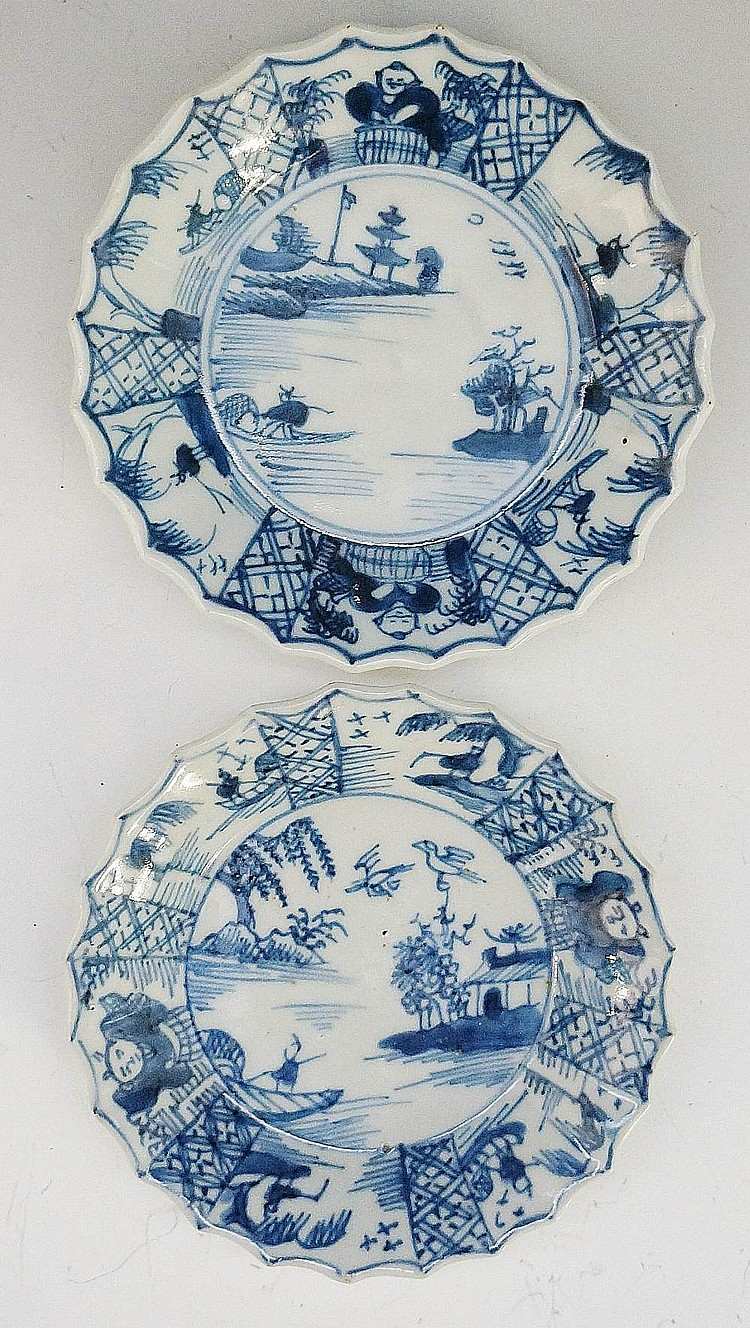 A pair of miniature Chinese shaped circular small dishes, painted to the ce