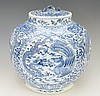 A large Chinese blue and white ginger jar, painted to the body with dragons