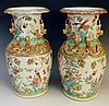 A pair of Cantonese famille rose baluster vases with pairs of gilt dog of f