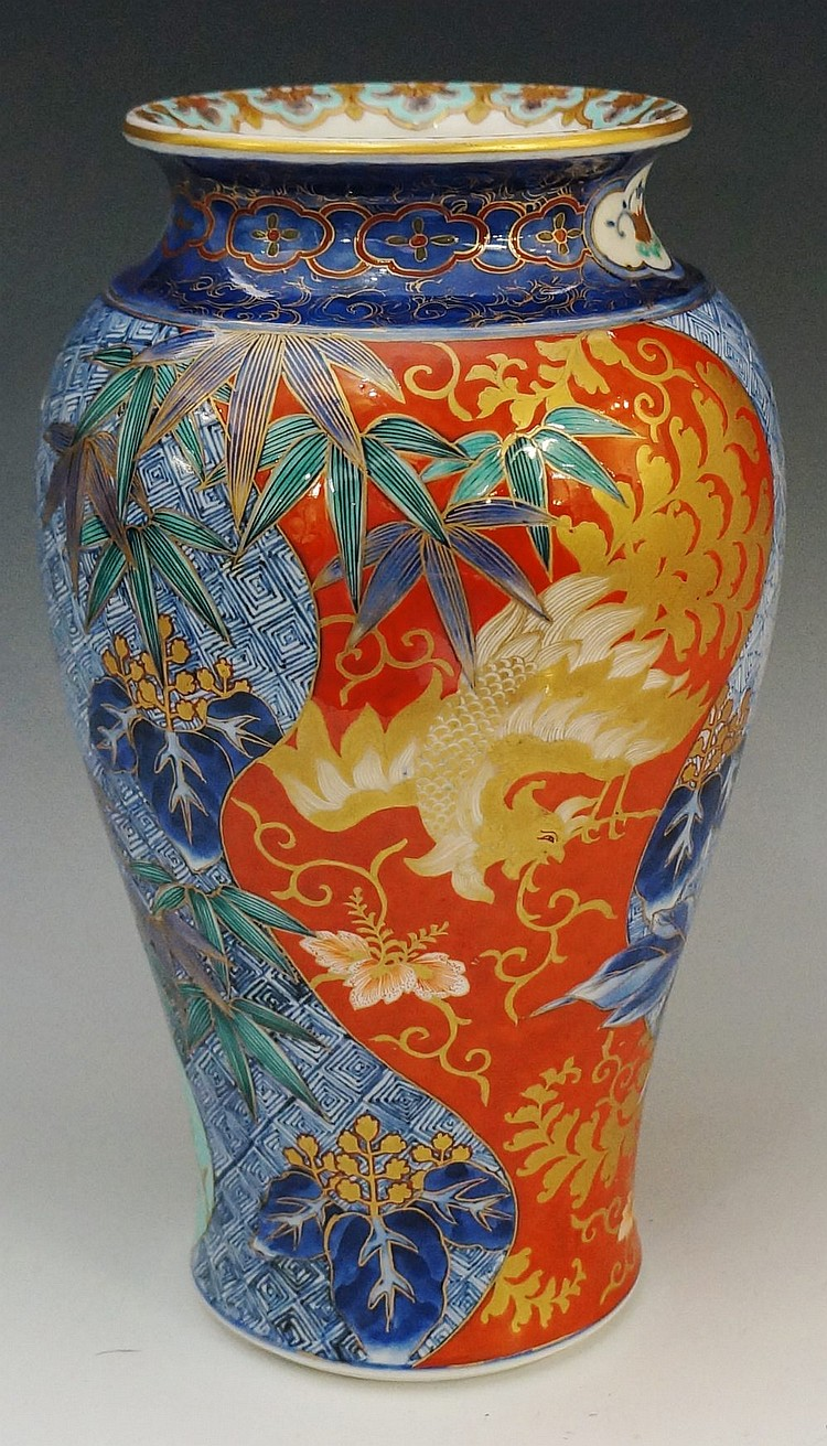 A Chinese baluster vase with spreading circular neck, the rim decorated wit
